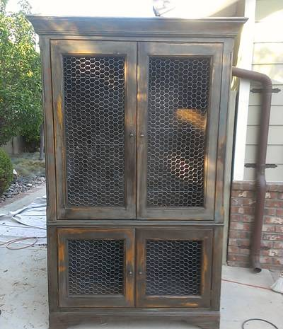 Incroyable A Distressed Chicken Wire Cabinet Is Standing In Courtyard.