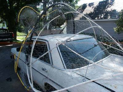 Chicken wire mesh and tubes are made into a frame for car.