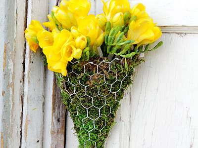 A triangle basket shaped floral decoration is placed on the door.