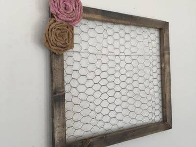 Chicken wire frame with faux flower on the upper left corner.
