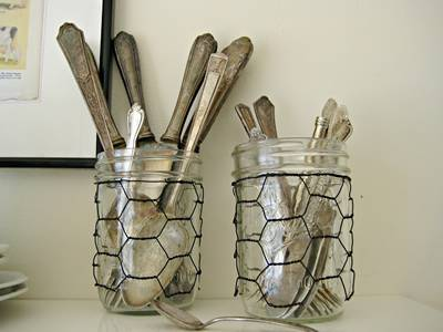 Two bottles of brushes is placed here, with chicken wire wrapping it.