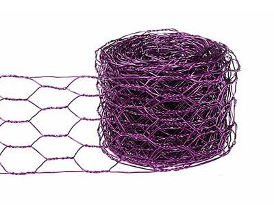 A roll of purple chicken wire ribbon is lying there with part of ribbon extended.