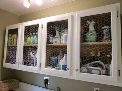 A white chicken wire shelf is placed in bathroom, and therefore, many toiletries inside.