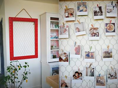 The blank wall is filled with chicken wire mesh and postcards.