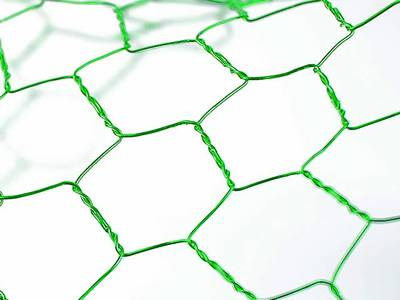 A piece of craft chicken wire in apple green color