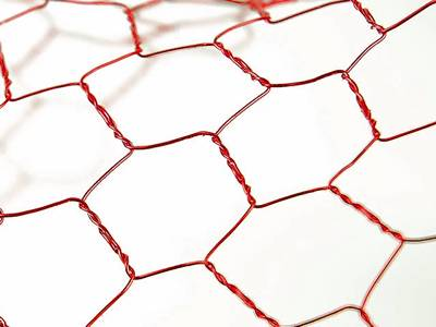 A piece of red craft chicken wire