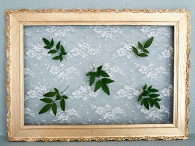 Yellow painted wood, chicken wire mesh, leaves are joined together to be a chicken wire frame.