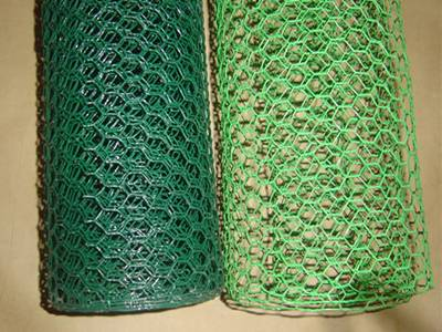 Two rolls of hexagonal wire mesh, one in green color, another apple green color
