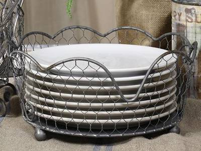 A galvanized chicken wire basket is placed here to contain dishes.