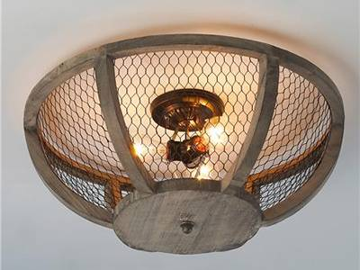Chicken wire mesh, together with wood frame, is made into a protection shade for pendant light.