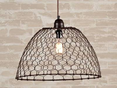 Blank coated chicken wire comes into a lampshade for a pendant light.