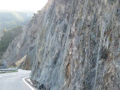 galvanized rock fall barrier protects slopes against landslides and insure the road safe
