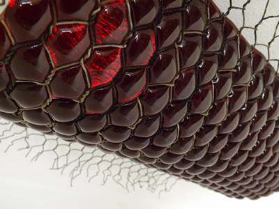 Red glass is kiln-formed into sculptural light.